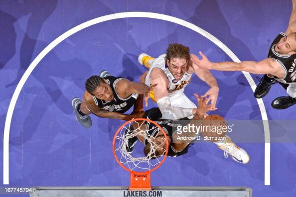 Pau Gasol of the Los Angeles Lakers attempts a layup against Tim Duncan Kawhi Leonard and Manu Ginobili of the San Antonio Spurs in Game Four of the...