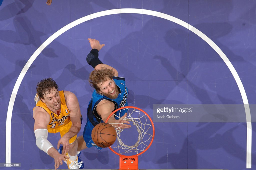 Pau Gasol #16 of the Los Angeles Lakers attempts a shot against Dirk Nowitzki #41 of the Dallas Mavericks at Staples Center on April 2, 2013 in Los Angeles, California.