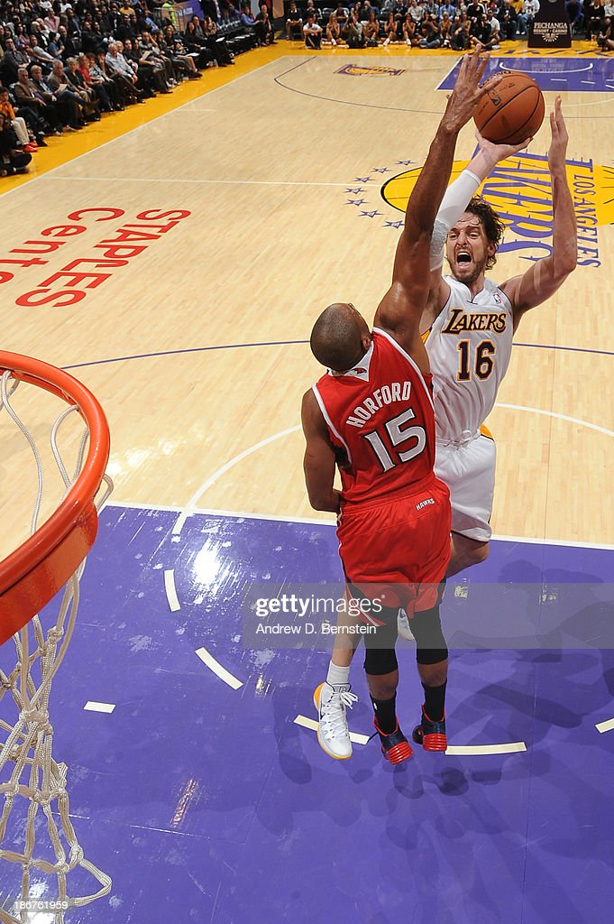 <a gi-track='captionPersonalityLinkClicked' href=/galleries/search?phrase=Pau+Gasol&family=editorial&specificpeople=201587 ng-click='$event.stopPropagation()'>Pau Gasol</a> #16 of the Los Angeles Lakers attempts a shot against the Atlanta Hawks on November 3, 2013 at STAPLES Center in Los Angeles, California.