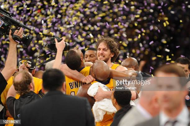 Pau Gasol of the Los Angeles Lakers celebrates with teammates Andrew Bynum and Lamar Odom following their team's victory over the Boston Celtics in...