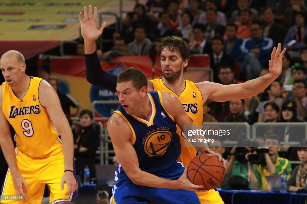 <a gi-track='captionPersonalityLinkClicked' href=/galleries/search?phrase=Pau+Gasol&family=editorial&specificpeople=201587 ng-click='$event.stopPropagation()'>Pau Gasol</a> #16 of the Los Angeles Lakers competes against David Lee #10 of the Golden State Warriors during the NBA Global Games 2013 Beijing game on October 15, 2013 at the MasterCard Center in Beijing, China.