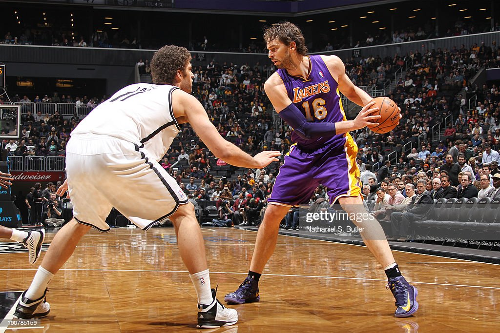 Pau Gasol #16 of the Los Angeles Lakers controls the ball against Brook Lopez #11 of the Brooklyn Nets on February 5, 2013 at the Barclays Center in the Brooklyn borough of New York City.