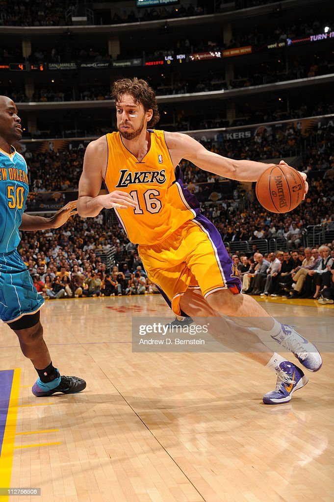 Pau Gasol of the Los Angeles Lakers dribbles against Emeka Okafor of the New Orleans Hornets in Game Two of the Western Conference Quarterfinals in...