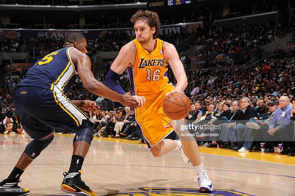 Pau Gasol #16 of the Los Angeles Lakers drives against Derrick Favors #15 of the Utah Jazz at Staples Center on January 25, 2013 in Los Angeles, California.