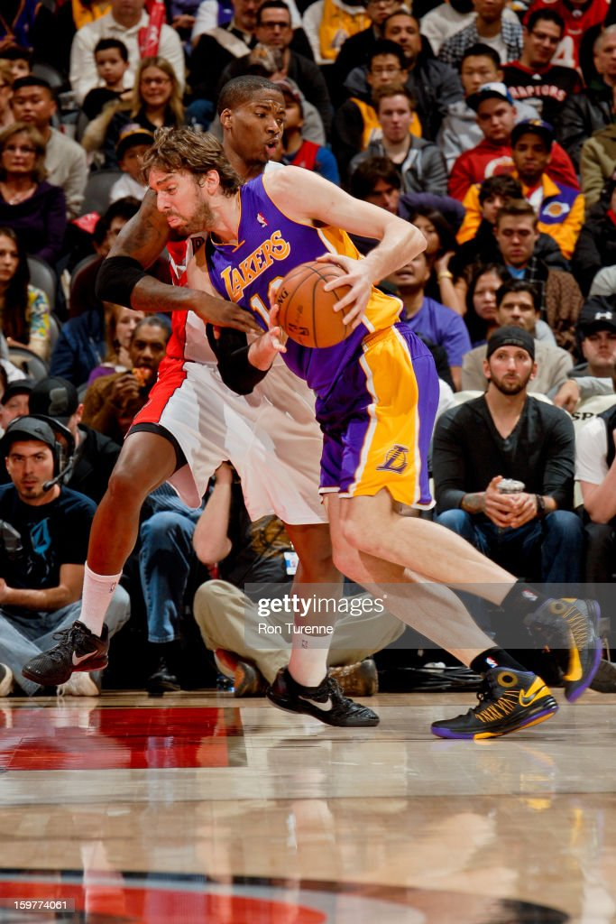 Pau Gasol #16 of the Los Angeles Lakers drives against Ed Davis #32 of the Toronto Raptors on January 20, 2013 at the Air Canada Centre in Toronto, Ontario, Canada.