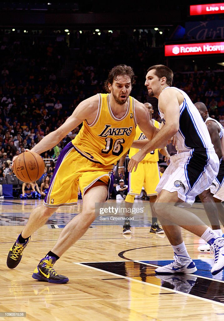 <a gi-track='captionPersonalityLinkClicked' href=/galleries/search?phrase=Pau+Gasol&family=editorial&specificpeople=201587 ng-click='$event.stopPropagation()'>Pau Gasol</a> #16 of the Los Angeles Lakers drives against Ryan Anderson #33 of the Orlando Magic during the game at Amway Arena on February 13, 2011 in Orlando, Florida.