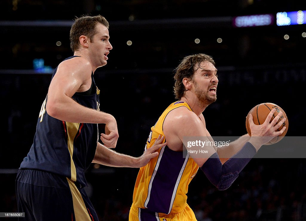 Pau Gasol #16 of the Los Angeles Lakers drives past Jason Smith #14 of the New Orleans Pelicans at Staples Center on November 12, 2013 in Los Angeles, California.