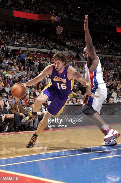 Pau Gasol of the Los Angeles Lakers drives to the basket against Jason Maxiell of the Detroit Pistons during the game at the Palace of Auburn Hills...