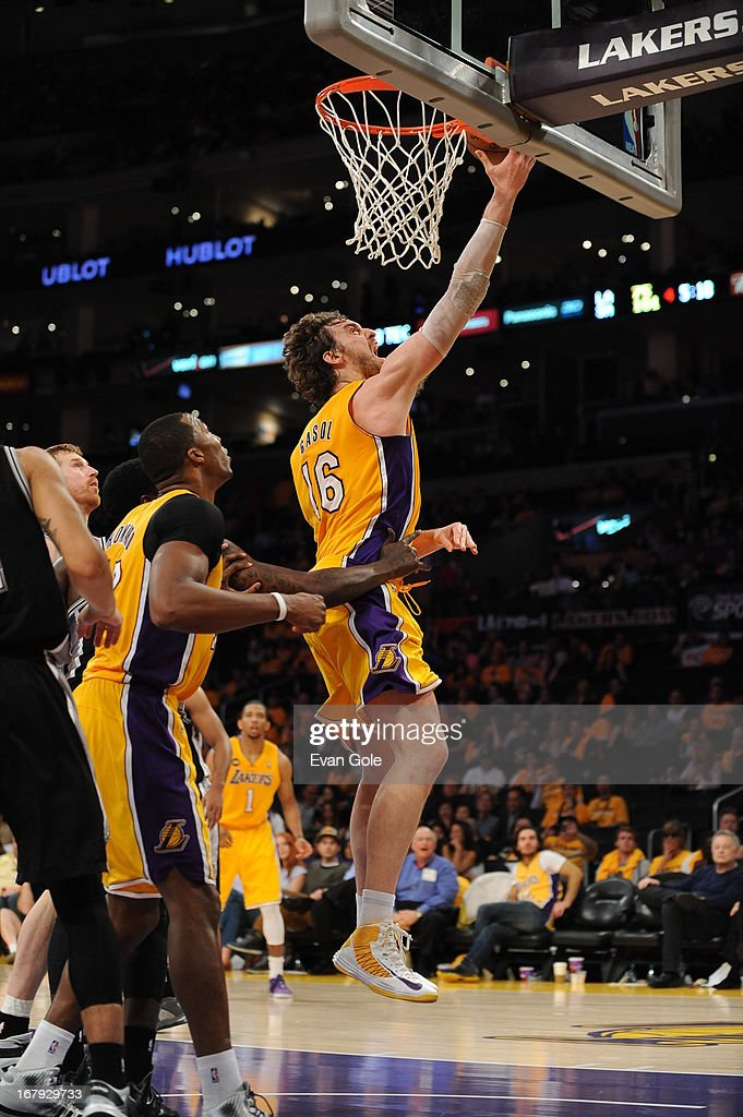 <a gi-track='captionPersonalityLinkClicked' href=/galleries/search?phrase=Pau+Gasol&family=editorial&specificpeople=201587 ng-click='$event.stopPropagation()'>Pau Gasol</a> #16 of the Los Angeles Lakers drives to the basket against the San Antonio Spurs at Staples Center in Game Three of the Western Conference Quarterfinals during the 2013 NBA Playoffs on April 26, 2013 in Los Angeles, California.