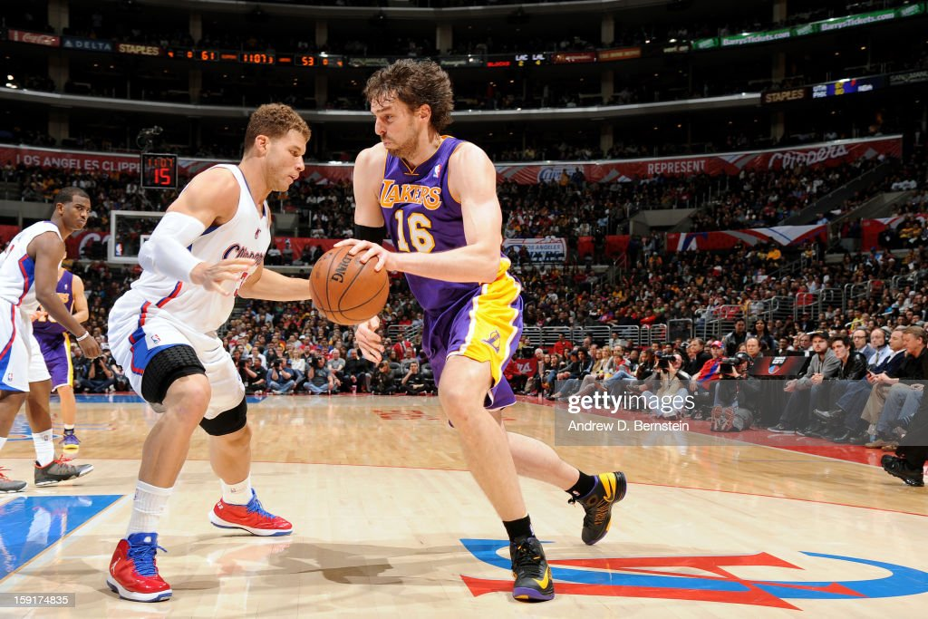 <a gi-track='captionPersonalityLinkClicked' href=/galleries/search?phrase=Pau+Gasol&family=editorial&specificpeople=201587 ng-click='$event.stopPropagation()'>Pau Gasol</a> #16 of the Los Angeles Lakers drives to the hoop against <a gi-track='captionPersonalityLinkClicked' href=/galleries/search?phrase=Blake+Griffin+-+Basketball+Player&family=editorial&specificpeople=4216010 ng-click='$event.stopPropagation()'>Blake Griffin</a> #23 of the Los Angeles Clippers at Staples Center on January 4, 2013 in Los Angeles, California.
