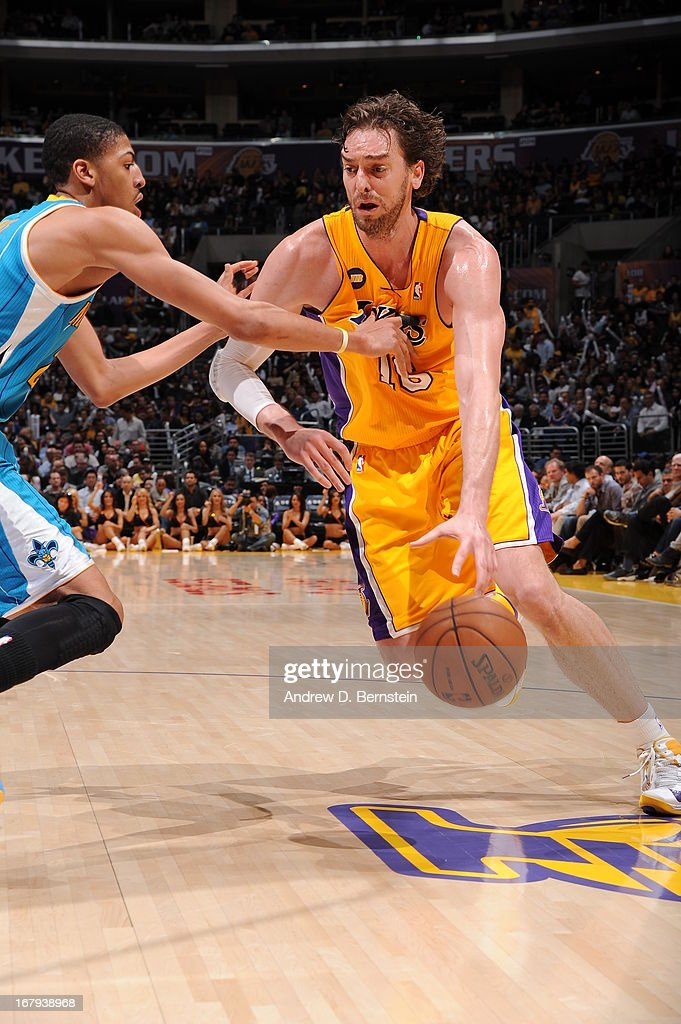 Pau Gasol #16 of the Los Angeles Lakers drives to the hoop against the New Orleans Hornets at Staples Center on April 9, 2013 in Los Angeles, California.