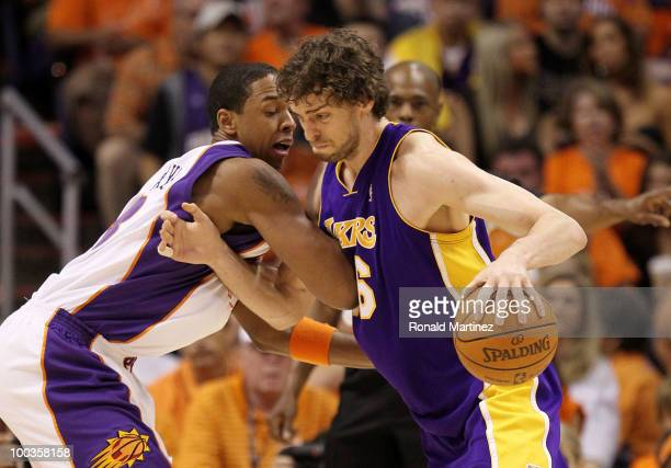 Pau Gasol of the Los Angeles Lakers drives with the ball against Channing Frye of the Phoenix Suns in the first quarter of Game Three of the Western...
