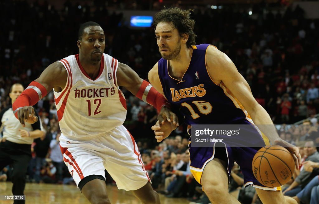 <a gi-track='captionPersonalityLinkClicked' href=/galleries/search?phrase=Pau+Gasol&family=editorial&specificpeople=201587 ng-click='$event.stopPropagation()'>Pau Gasol</a> #16 of the Los Angeles Lakers drives with the ball past <a gi-track='captionPersonalityLinkClicked' href=/galleries/search?phrase=Dwight+Howard&family=editorial&specificpeople=201570 ng-click='$event.stopPropagation()'>Dwight Howard</a> #12 of the Houston Rockets during the game at Toyota Center on November 7, 2013 in Houston, Texas.