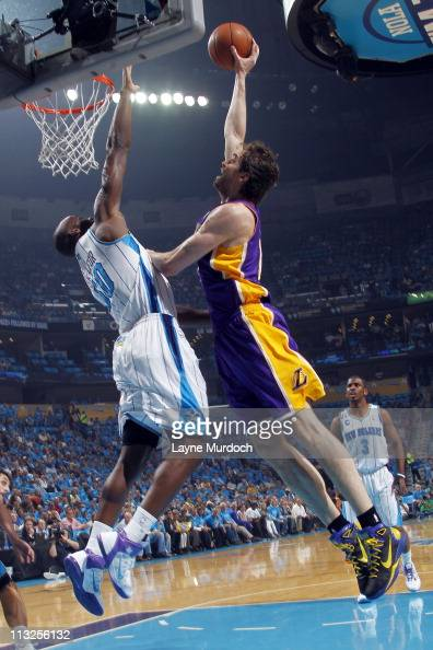 Pau Gasol of the Los Angeles Lakers dunks against Emeka Okafor of the New Orleans Hornets in Game Six of the Western Conference Quarterfinals in the...