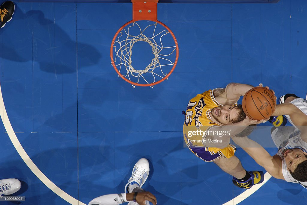 Pau Gasol #16 of the Los Angeles Lakers dunks against Hedo Turkoglu #15 of the Orlando Magic on February 13, 2011 at the Amway Center in Orlando, Florida.