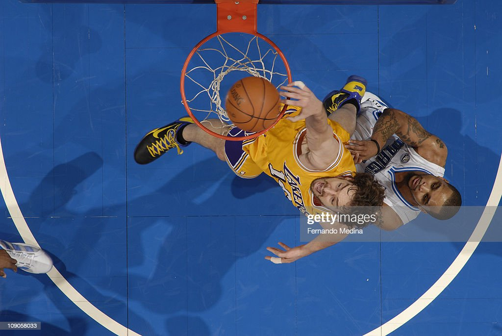 <a gi-track='captionPersonalityLinkClicked' href=/galleries/search?phrase=Pau+Gasol&family=editorial&specificpeople=201587 ng-click='$event.stopPropagation()'>Pau Gasol</a> #16 of the Los Angeles Lakers dunks against Jameer Nelson #14 of the Orlando Magic on February 13, 2011 at the Amway Center in Orlando, Florida.