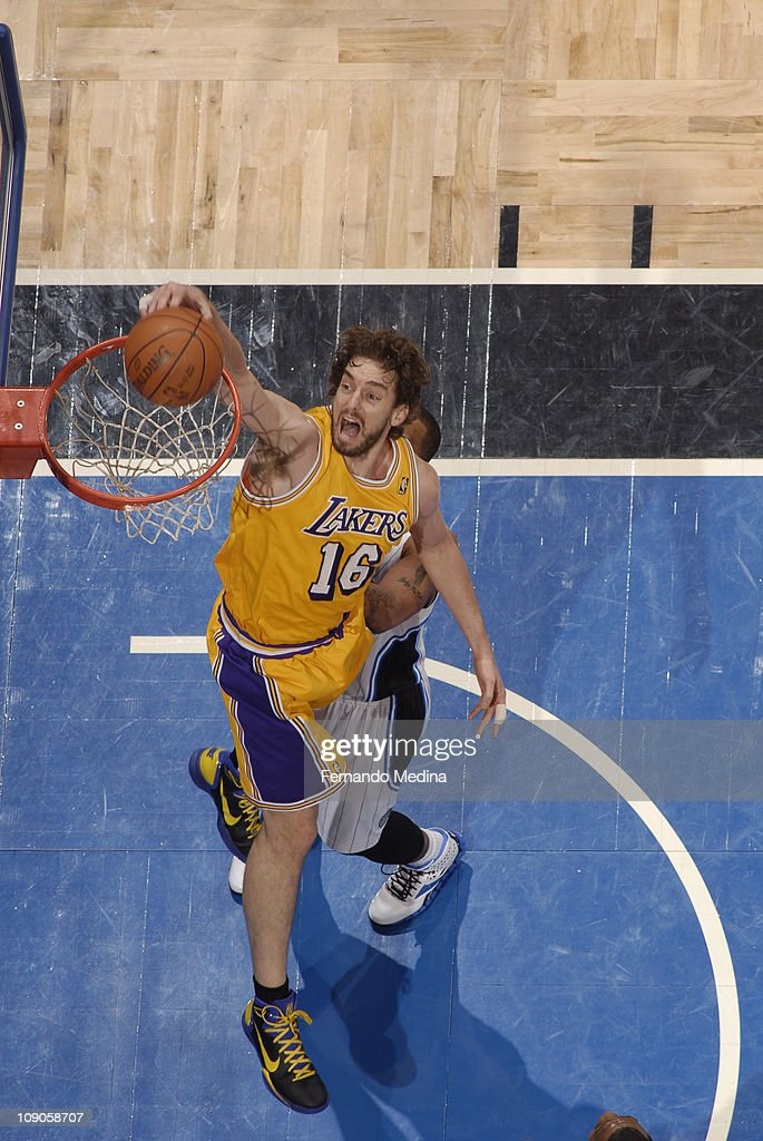 Pau Gasol #16 of the Los Angeles Lakers dunks against <a gi-track='captionPersonalityLinkClicked' href=/galleries/search?phrase=Jameer+Nelson&family=editorial&specificpeople=202057 ng-click='$event.stopPropagation()'>Jameer Nelson</a> #14 of the Orlando Magic on February 13, 2011 at the Amway Center in Orlando, Florida.