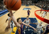 Pau Gasol of the Los Angeles Lakers dunks against Marc Gasol of the Memphis Grizzlies on February 7 2011 at FedExForum in Memphis Tennessee NOTE TO...