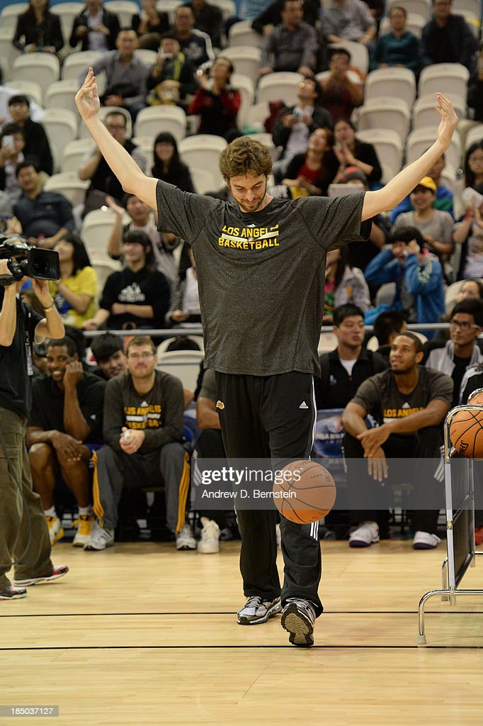 Pau Gasol of the Los Angeles Lakers gets the crowd going during Fan Appreciation Day as part of the 2013 Global Games on October 17, 2013 at the Oriental Sports Center in Shanghai, China.