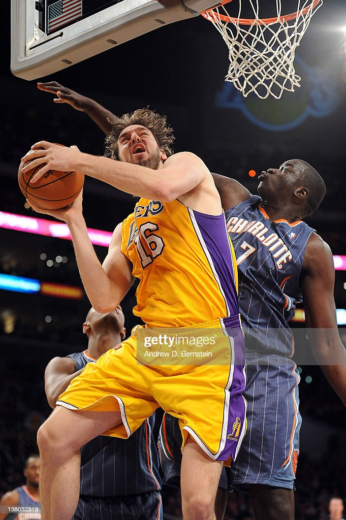 Pau Gasol #16 of the Los Angeles Lakers goes to the basket against DeSagana Diop #7 of the Charlotte Bobcats at Staples Center on January 31, 2012 in Los Angeles, California.