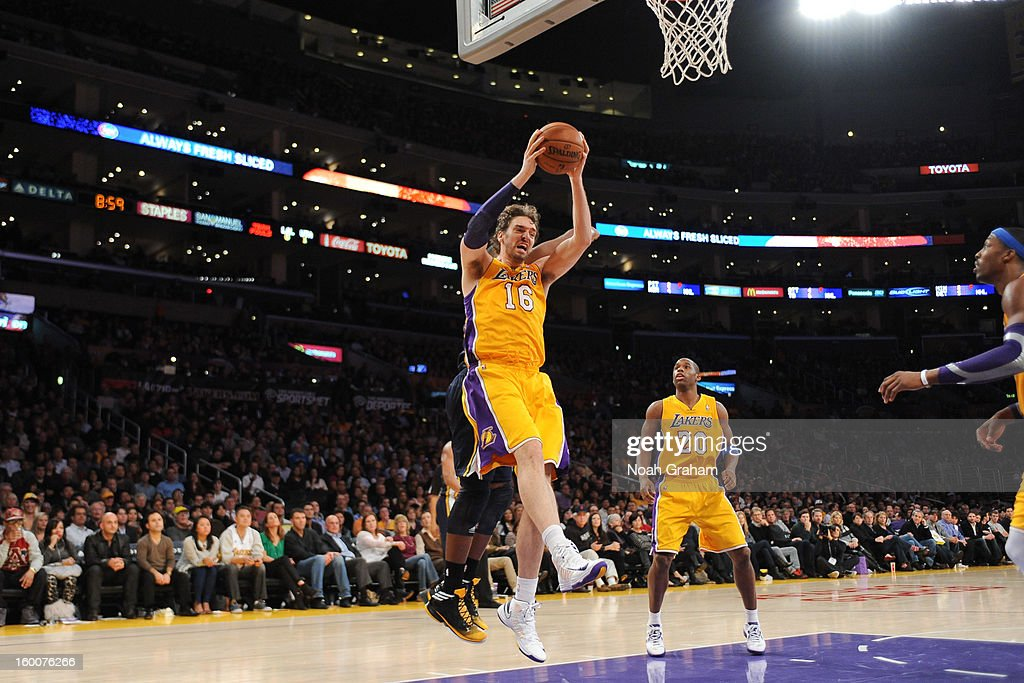 Pau Gasol #16 of the Los Angeles Lakers grabs a rebound against the Utah Jazz at Staples Center on January 25, 2013 in Los Angeles, California.