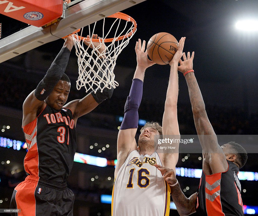 <a gi-track='captionPersonalityLinkClicked' href=/galleries/search?phrase=Pau+Gasol&family=editorial&specificpeople=201587 ng-click='$event.stopPropagation()'>Pau Gasol</a> #16 of the Los Angeles Lakers grabs a rebound in front of <a gi-track='captionPersonalityLinkClicked' href=/galleries/search?phrase=Terrence+Ross&family=editorial&specificpeople=6781663 ng-click='$event.stopPropagation()'>Terrence Ross</a> #31 of the Toronto Raptors and <a gi-track='captionPersonalityLinkClicked' href=/galleries/search?phrase=Amir+Johnson&family=editorial&specificpeople=556786 ng-click='$event.stopPropagation()'>Amir Johnson</a> #15 at Staples Center on December 8, 2013 in Los Angeles, California.