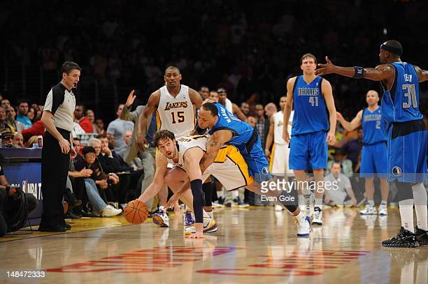 Pau Gasol of the Los Angeles Lakers handles the ball against Shawn Marion of the Dallas Mavericks on April 15 2012 in Los Angeles California NOTE TO...