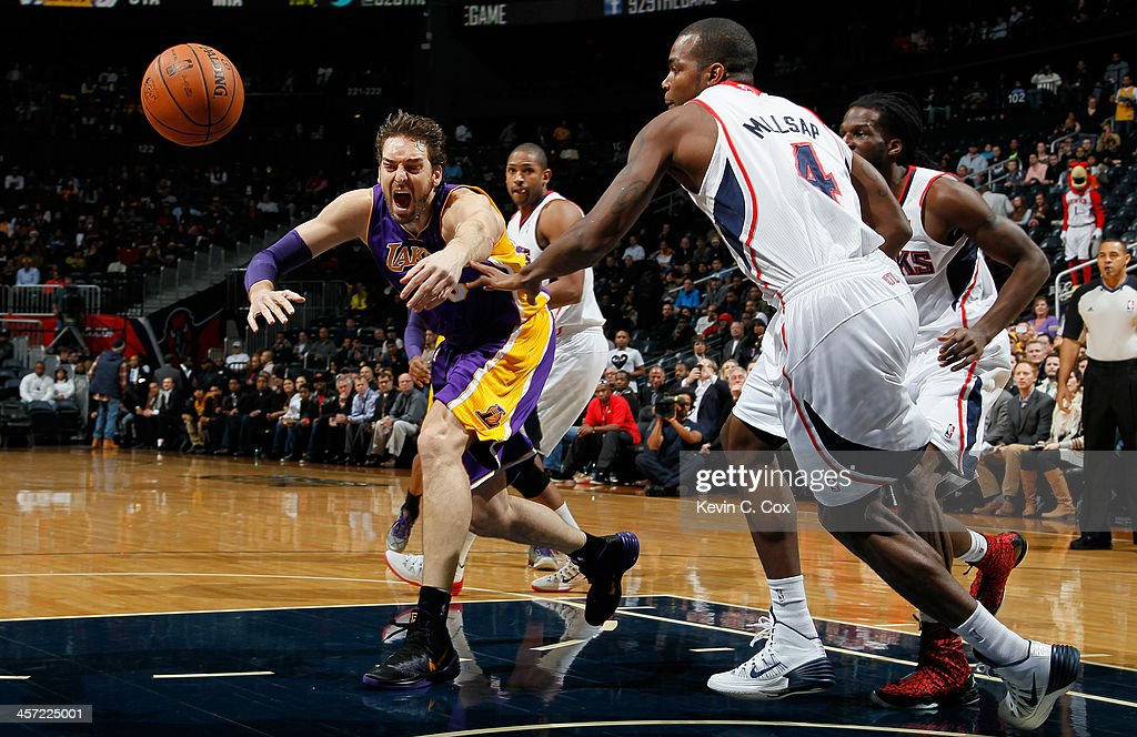 <a gi-track='captionPersonalityLinkClicked' href=/galleries/search?phrase=Pau+Gasol&family=editorial&specificpeople=201587 ng-click='$event.stopPropagation()'>Pau Gasol</a> #16 of the Los Angeles Lakers has the ball stripped against <a gi-track='captionPersonalityLinkClicked' href=/galleries/search?phrase=Paul+Millsap&family=editorial&specificpeople=880017 ng-click='$event.stopPropagation()'>Paul Millsap</a> #4 of the Atlanta Hawks at Philips Arena on December 16, 2013 in Atlanta, Georgia.