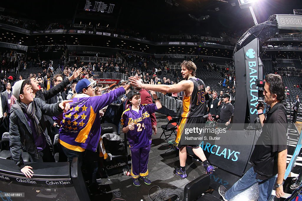 Pau Gasol #16 of the Los Angeles Lakers high fives fans after defeating the Brooklyn Nets at Barclays Center on November 27, 2013 in the Brooklyn borough of New York City.
