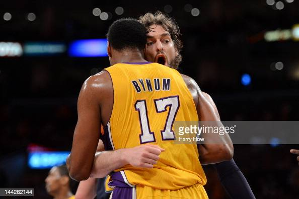 Pau Gasol of the Los Angeles Lakers hugs Andrew Bynum in the first quarter as the Lakers take on the Denver Nuggets in Game Seven of the Western...