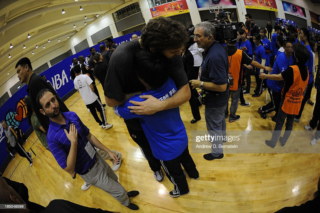 Pau Gasol of the Los Angeles Lakers interacts with a participant during the NBA Cares Special Olympics Clinic as part of the 2013 Global Games on October 17, 2013 at the Oriental Sports Center in Shanghai, China.