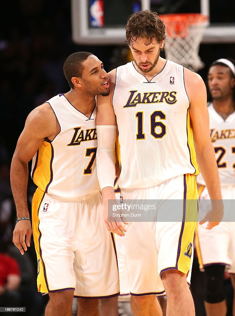 Pau Gasol #16 of the Los Angeles Lakers is congratulated by Xavier Henry #7 after Gasol made two foul shots to put the Lakers ahead by two points with six seconds remaning against the Atlanta Hawks at Staples Center on November 3, 2013 in Los Angeles, California. The Lakers won 105-103.