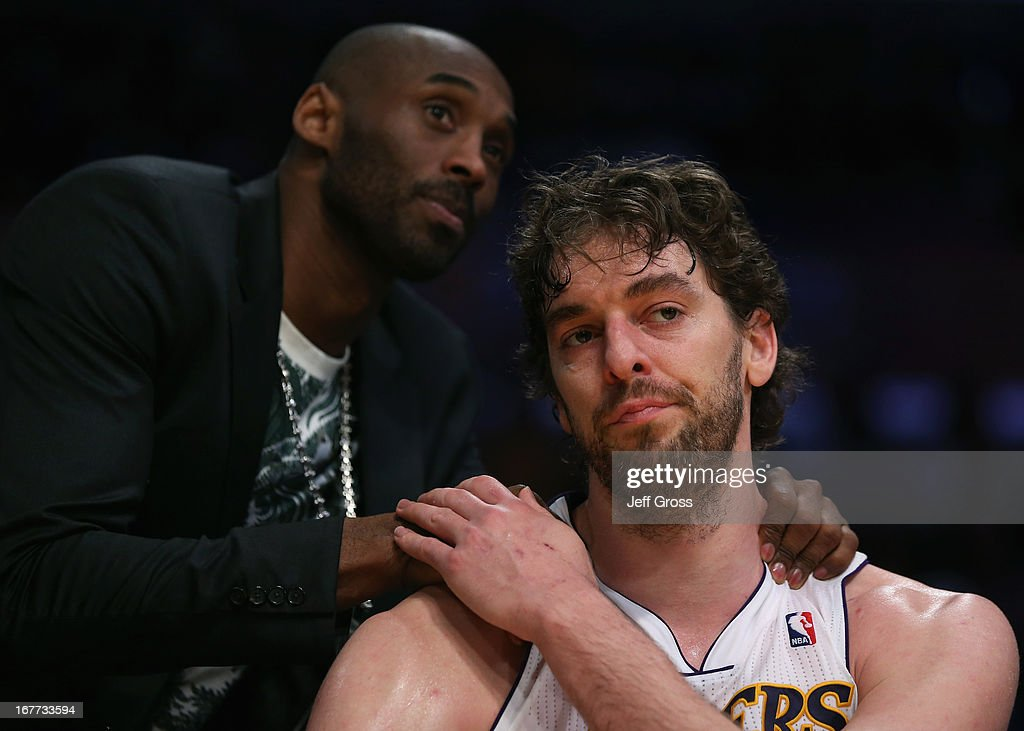 Pau Gasol #16 of the Los Angeles Lakers is consoled by Kobe Bryant after coming out of the game in the second half against the San Antonio Spurs during Game Four of the Western Conference Quarterfinals of the 2013 NBA Playoffs at Staples Center on April 28, 2013 in Los Angeles, California. The Spurs defeated the Lakers 103-82.