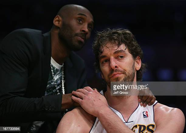 Pau Gasol of the Los Angeles Lakers is consoled by Kobe Bryant after coming out of the game in the second half against the San Antonio Spurs during...