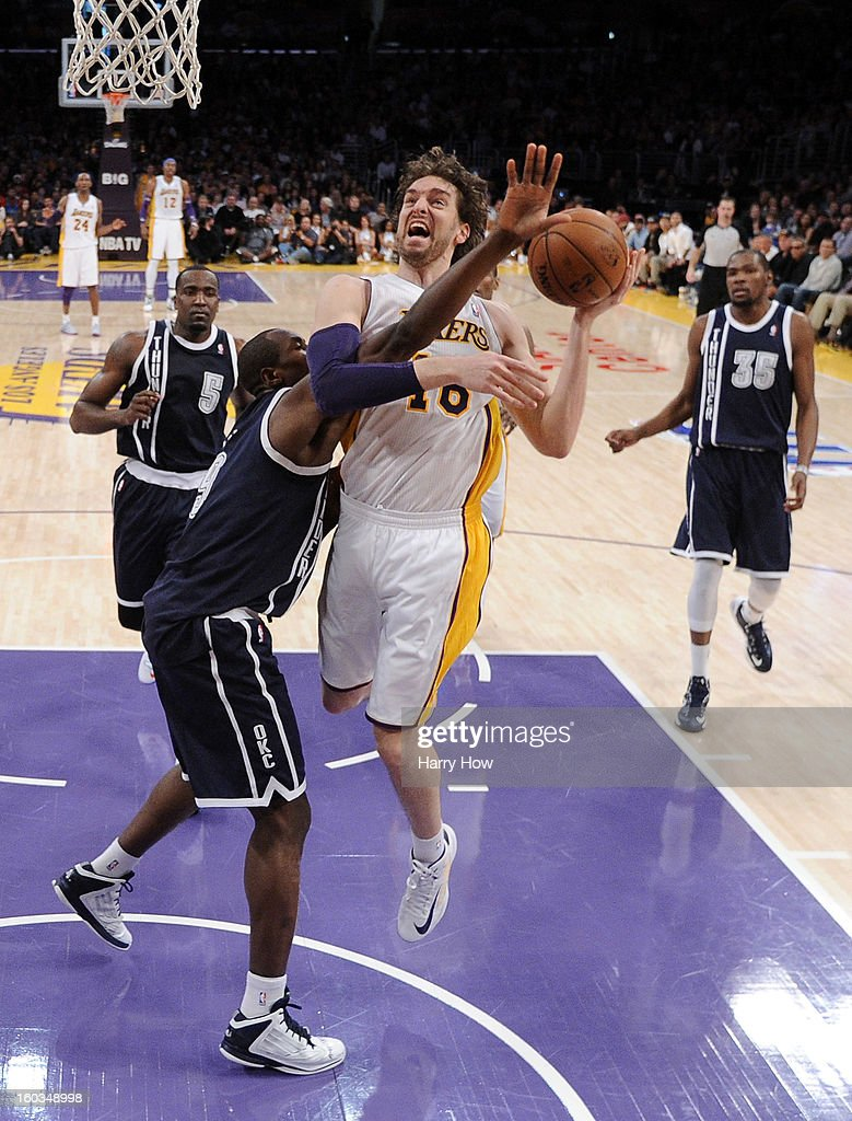 Pau Gasol #16 of the Los Angeles Lakers is fouled as he attempts a shot by Serge Ibaka #9 of the Oklahoma City Thunder at Staples Center on January 27, 2013 in Los Angeles, California.