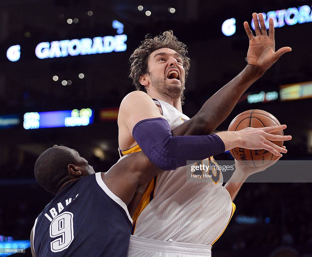 Pau Gasol #16 of the Los Angeles Lakers is fouled by Serge Ibaka #9 of the Oklahoma City Thunder at Staples Center on January 27, 2013 in Los Angeles, California.