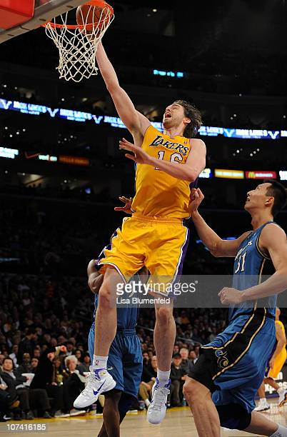 Pau Gasol of the Los Angeles Lakers lays a shot up against the Washington Wizards at Staples Center on December 7 2010 in Los Angeles California NOTE...