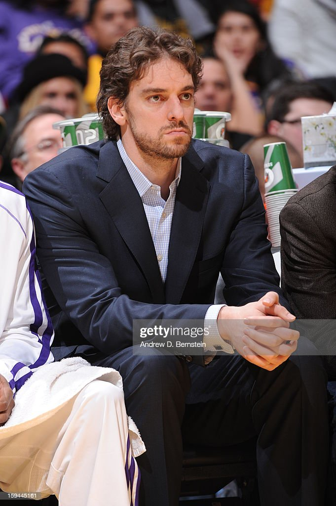 Pau Gasol #16 of the Los Angeles Lakers looks on from the bench in street clothes during a game against the Cleveland Cavaliers at Staples Center on January 13, 2013 in Los Angeles, California.