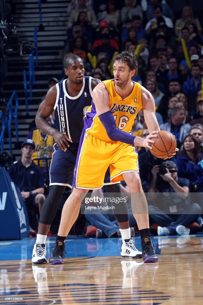 Pau Gasol #16 of the Los Angeles Lakers passes the ball against the Oklahoma City Thunder on December 13, 2013 at the Chesapeake Energy Arena in Oklahoma City, Oklahoma.