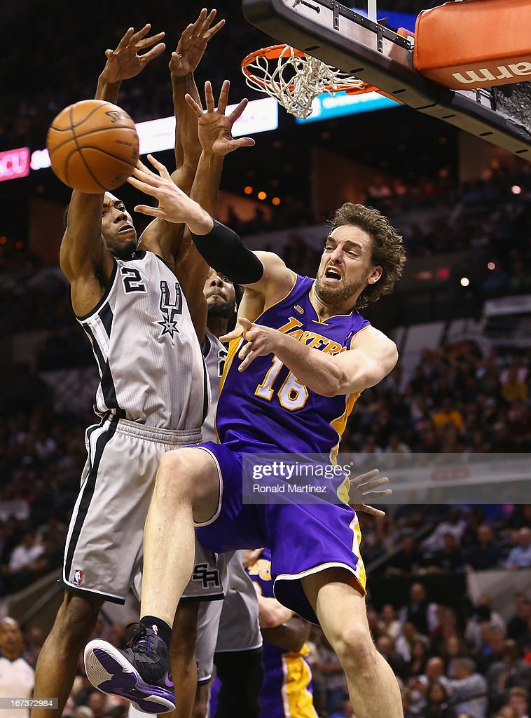 Pau Gasol #16 of the Los Angeles Lakers passes the ball in front of Kawhi Leonard #2 of the San Antonio Spurs during Game Two of the Western Conference Quarterfinals of the 2013 NBA Playoffs at AT&T Center on April 24, 2013 in San Antonio, Texas.