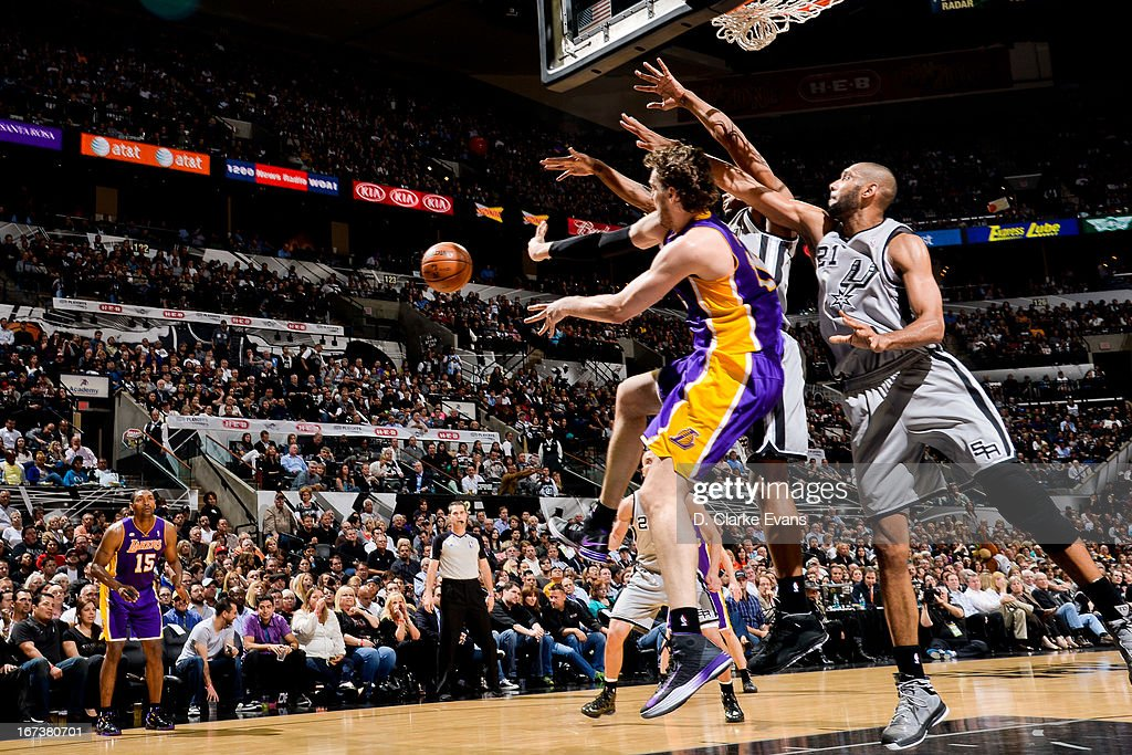 Pau Gasol #16 of the Los Angeles Lakers passes the ball out to teammate Metta World Peace #15 against Tim Duncan #21 of the San Antonio Spurs in Game Two of the Western Conference Quarterfinals during the 2013 NBA Playoffs on April 24, 2013 at the AT&T Center in San Antonio, Texas.