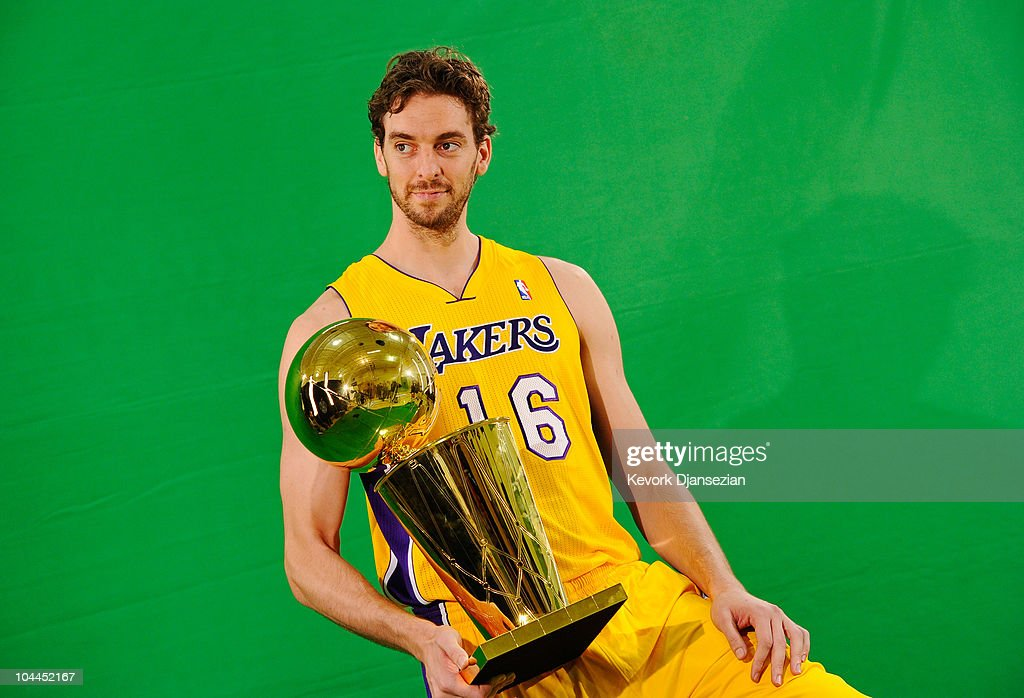 Pau Gasol #16 of the Los Angeles Lakers poses for a photograph with the NBA Finals Larry O'Brien Championship Trophy during Media Day at the Toyota Center on September 25, 2010 in El Segundo, California.