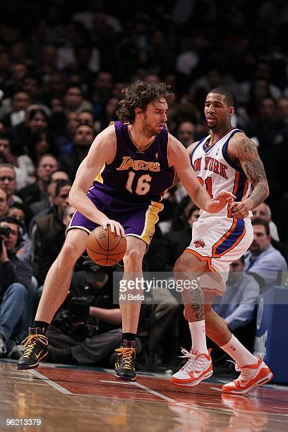 Pau Gasol of the Los Angeles Lakers posts up against Wilson Chandler of the New York Knicks during their game at Madison Square Garden on January 22...