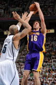 Pau Gasol of the Los Angeles Lakers puts up a shot over Carlos Boozer of the Utah Jazz in Game Three of the Western Conference Semifinals during the...