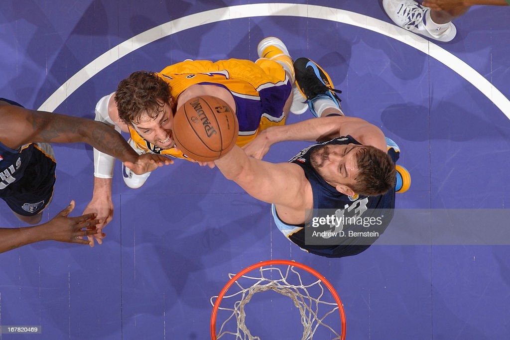 <a gi-track='captionPersonalityLinkClicked' href=/galleries/search?phrase=Pau+Gasol&family=editorial&specificpeople=201587 ng-click='$event.stopPropagation()'>Pau Gasol</a> #16 of the Los Angeles Lakers reaches for a rebound against <a gi-track='captionPersonalityLinkClicked' href=/galleries/search?phrase=Marc+Gasol&family=editorial&specificpeople=661205 ng-click='$event.stopPropagation()'>Marc Gasol</a> #33 of the Memphis Grizzlies at Staples Center on April 5, 2013 in Los Angeles, California.