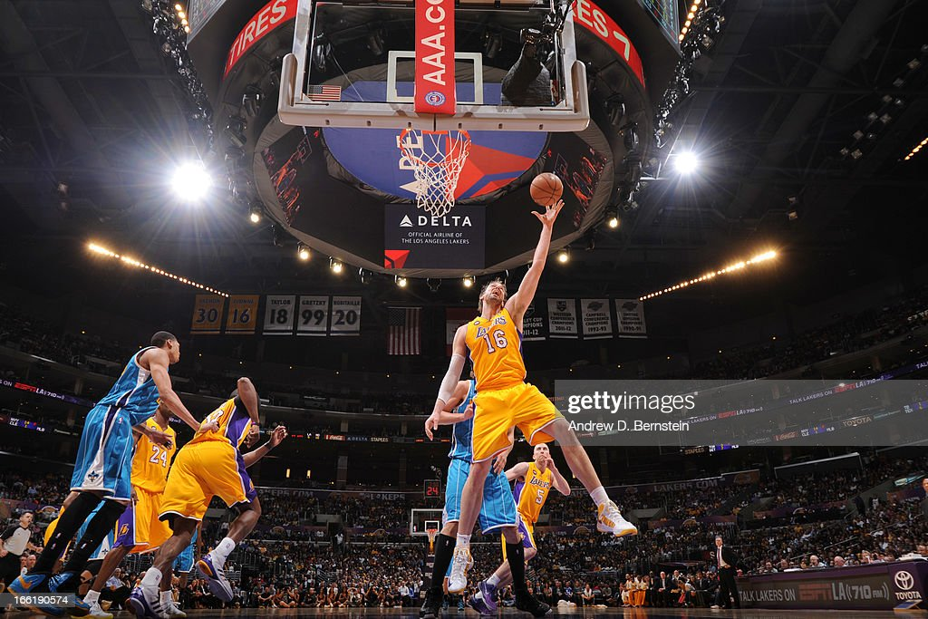 Pau Gasol #16 of the Los Angeles Lakers reaches for a rebound against the New Orleans Hornets at Staples Center on April 9, 2013 in Los Angeles, California.