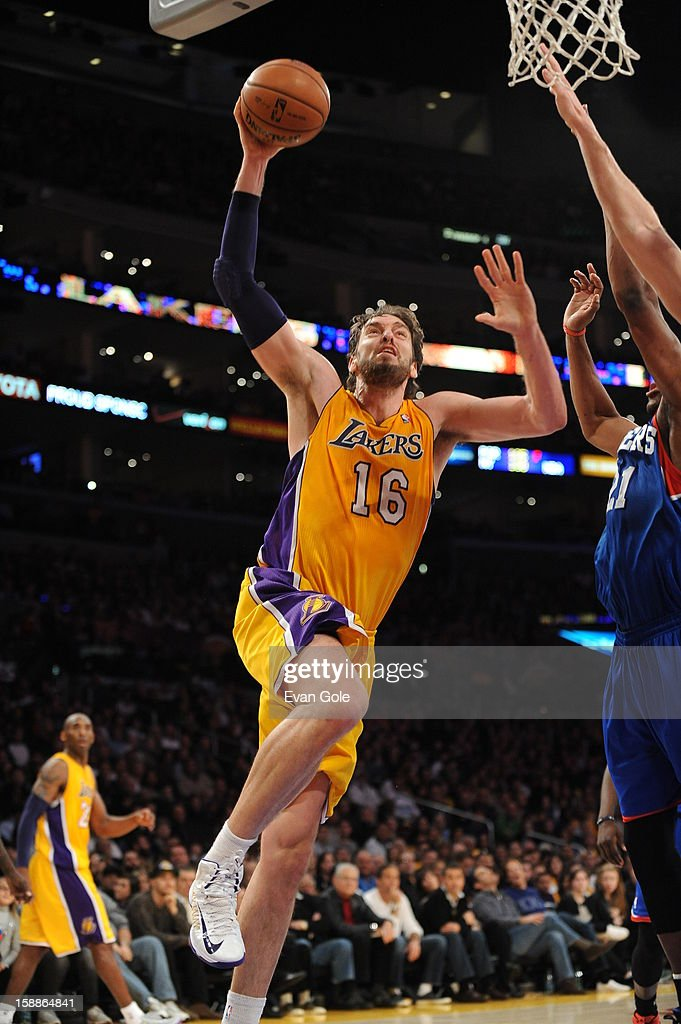 Pau Gasol #16 of the Los Angeles Lakers rises for a shot against Spencer Hawes #00 of the Philadelphia 76ers at Staples Center on January 1, 2013 in Los Angeles, California.