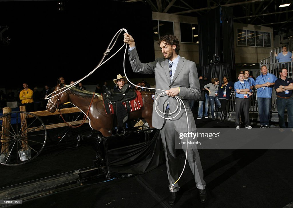 Pau Gasol of the Los Angeles Lakers ropes a fake calf during the 2010 NBA AllStar Celebrity Game presented by FINAL FANTASY XIII on center court...
