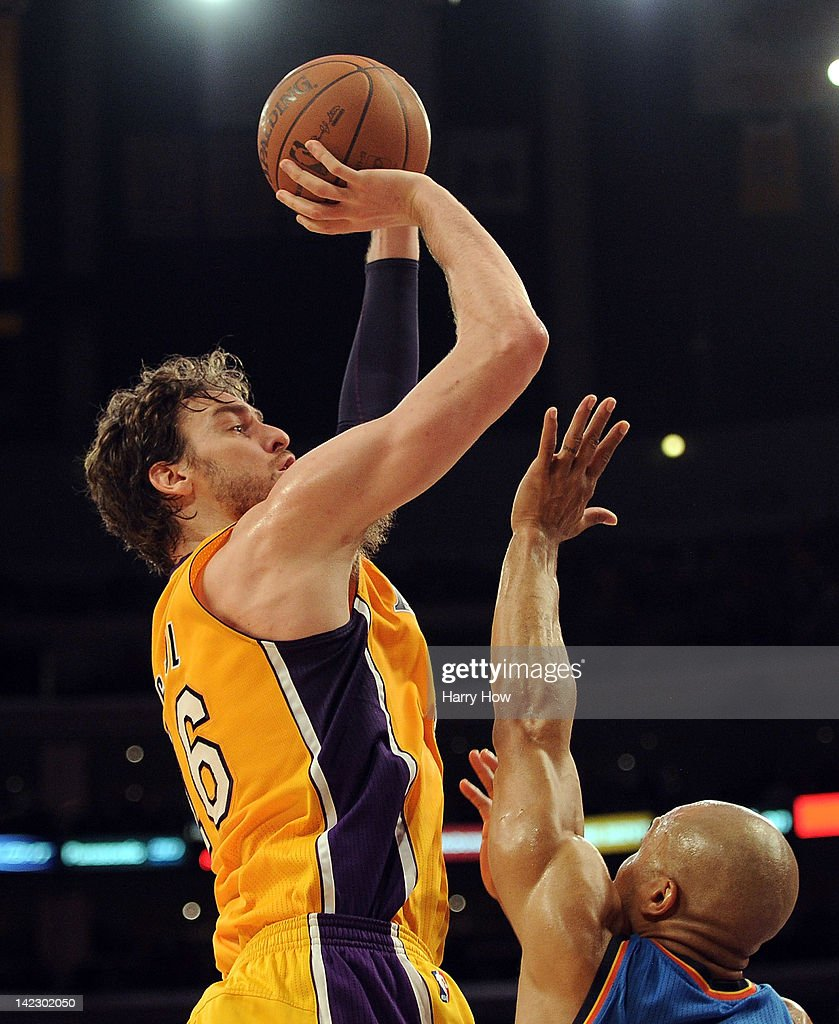 <a gi-track='captionPersonalityLinkClicked' href=/galleries/search?phrase=Pau+Gasol&family=editorial&specificpeople=201587 ng-click='$event.stopPropagation()'>Pau Gasol</a> #16 of the Los Angeles Lakers shoots a jumper over <a gi-track='captionPersonalityLinkClicked' href=/galleries/search?phrase=Derek+Fisher&family=editorial&specificpeople=201724 ng-click='$event.stopPropagation()'>Derek Fisher</a> #37 of the Oklahoma City Thunder at Staples Center on March 29, 2012 in Los Angeles, California.