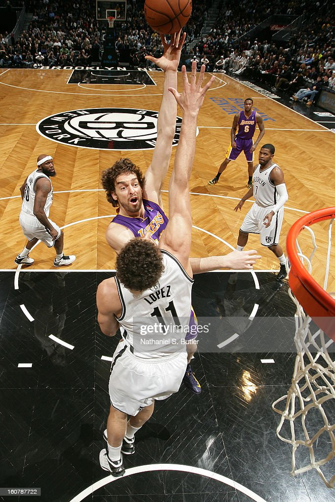 Pau Gasol #16 of the Los Angeles Lakers shoots against Brook Lopez #11 of the Brooklyn Nets on February 5, 2013 at the Barclays Center in the Brooklyn borough of New York City.